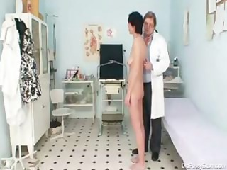 slender older brunette visits the wicked old gyno