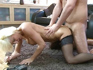 sexy golden-haired momma in hot corset and