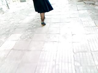 aged honey walking in darksome heels