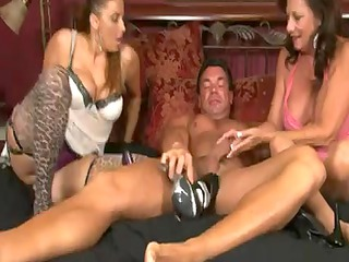 2 aged chicks give a stockings footjob
