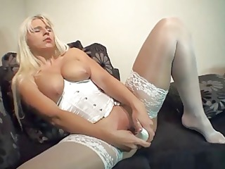 blond lady inserts high heel in her bawdy cleft