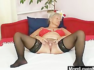 unsightly grandma cecilie toys her curly cunt