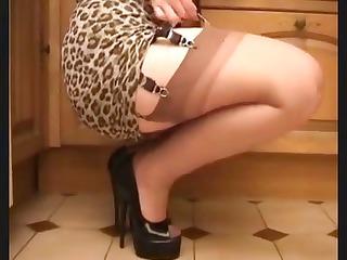 red-haired mommy in nylons on garter belt teases