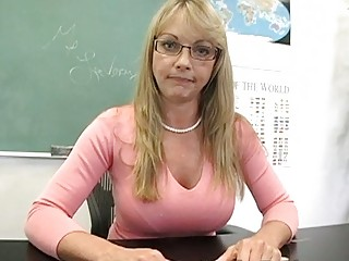 golden-haired aged teacher shows off her