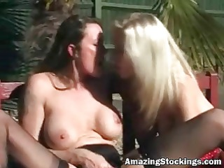 two milfs in hot nylons and garters making out