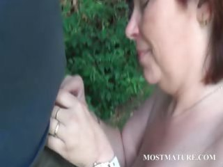 naked mommy blows hard rod outdoor