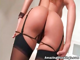 busty milf in sexy dark nylons playing with