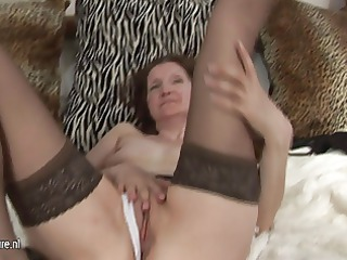 aged gilf playing with her toy