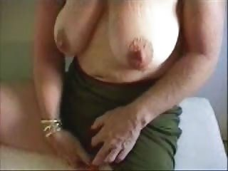 sexy granny stroking her large clitoris
