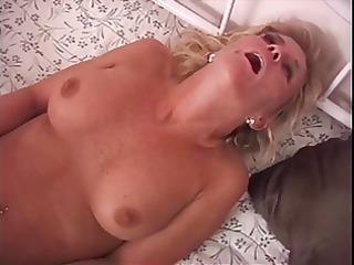 older blonde with nice tits sucks cowboys dick