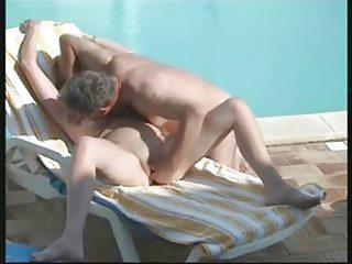 spying mummy and dad having fun near swimming pool