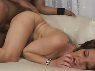 enormous chested brunette momma with tattoo