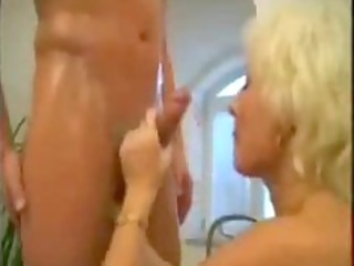 golden-haired aged mamma drilled in the bath
