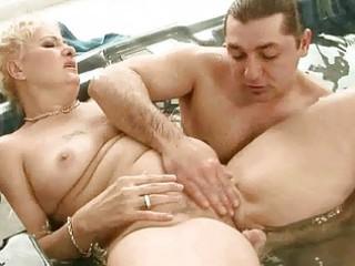 grandma enjoys sex in jacuzzi