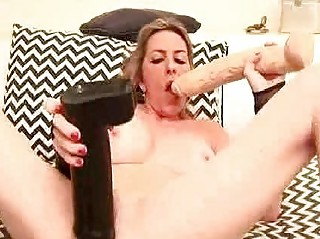 extraordinary milf fucks herself with a champagne
