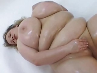 large breasted oiled milf masturbates in her