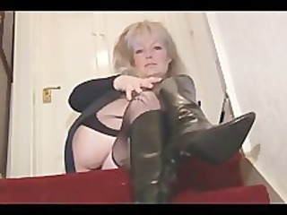 aged busty blonde playgirl in nylons and mini