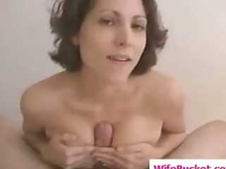 busty wife gives a titjob