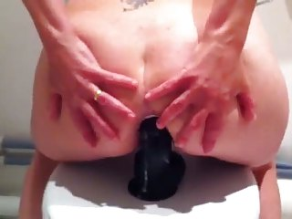 anal wife with large darksome sextoy in her arse