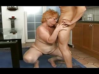 corpulent granny receives a facial from a boy