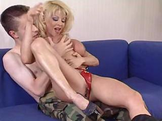 aged woman donna checks youthful soldier s skills