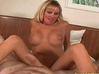 lexxi foxx milf rubbing a dong against her clit