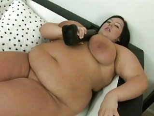 large dark haired momma with large breasts uses