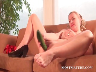 nasty mama nails her snatch with a cucumber