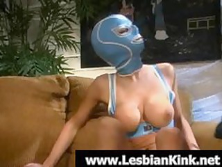 hawt lesbo in rubber mask engulfing a giant toy