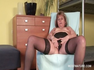 sexy golden-haired mature wide widening her pink