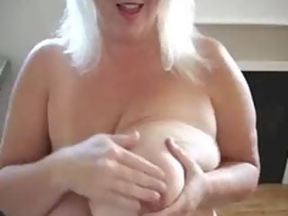 older play with her large titties