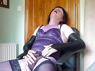 aged crossdresser in purple underware masturbates