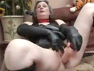 aged in fetish wear playing