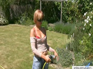 golden-haired milf outside cools off before