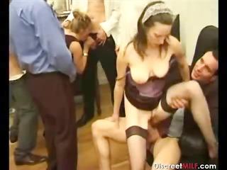 group of males on one older slut