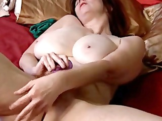older with large tits and shaggy cunt masturbates