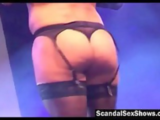 golden-haired in darksome lingerie gives a public