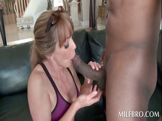 sexy cougar blowing a large dark shaft