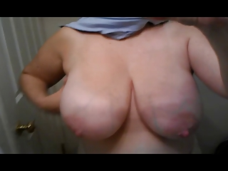 wife showing off her large milk cans (.)(.)