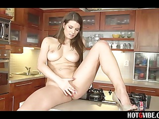 european milf masturbates in kitchen