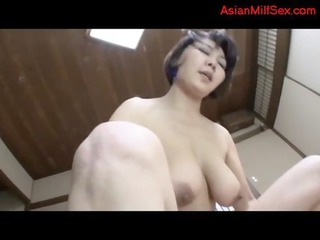 breasty aged woman getting her unshaved cunt