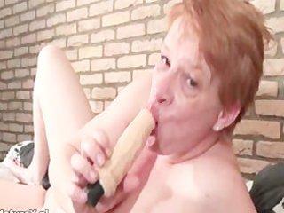 eager older woman engulfing biggest dildo part1