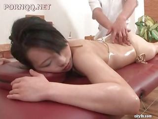 hot oriental beauty gets a fine oily massage and