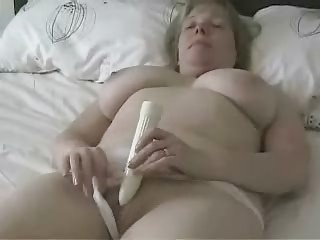 large titted mature mamma masturbating with a