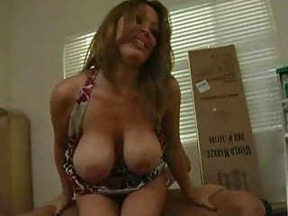brunette mother i with big mounds bounces up and