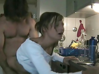 cheating wife copulates paramour in the kitchen