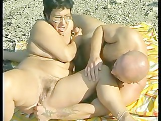granny receives team-fucked at the beach