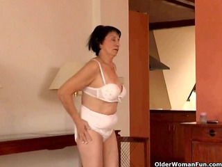 over 710 granny does striptease and masturbates