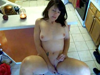 woman masturbates in the kitchen